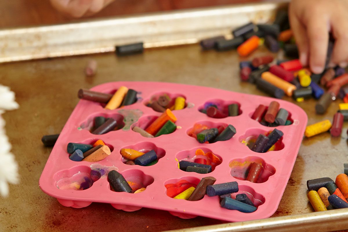 crayon nubs in pink tray