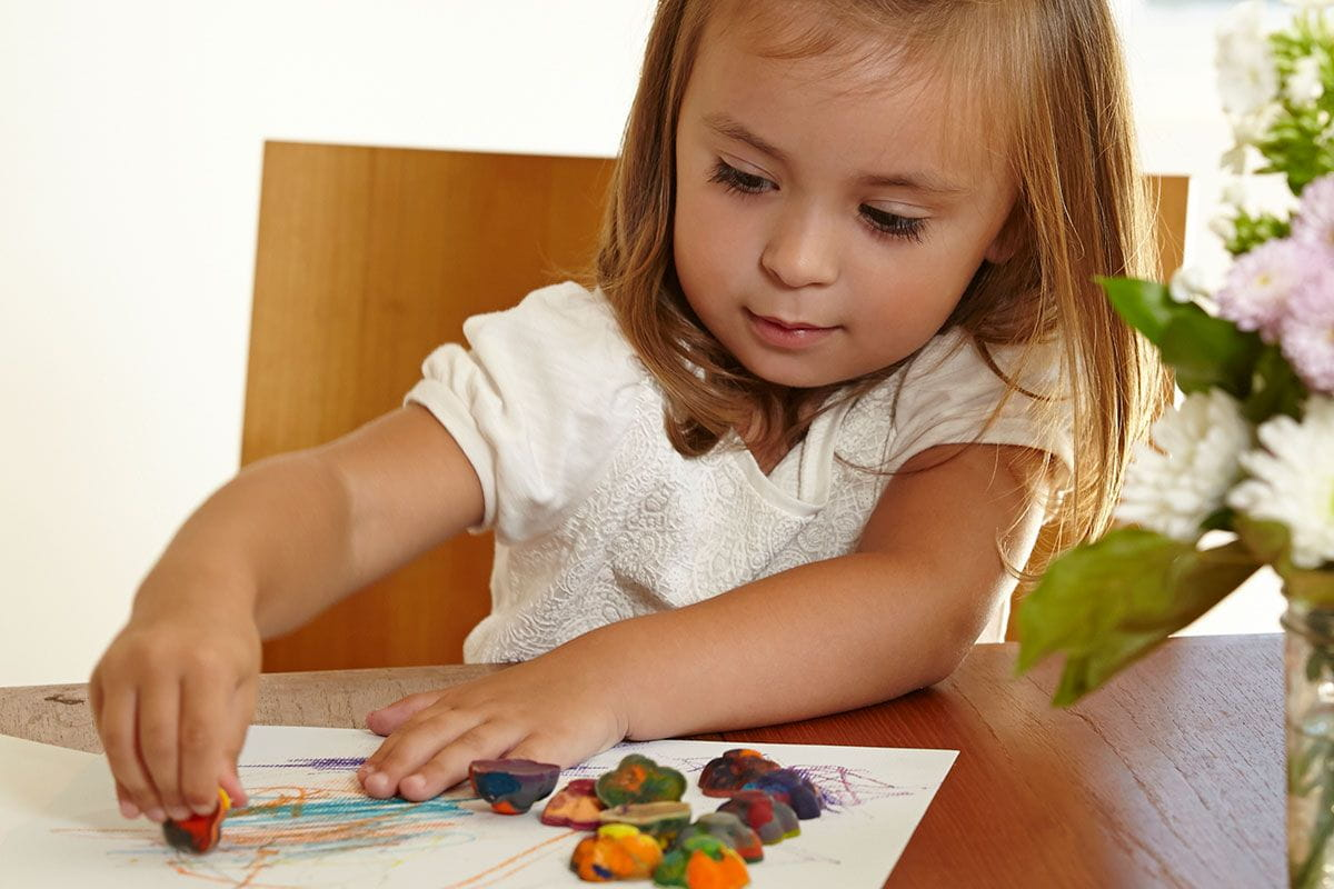little girl using coolest crayon