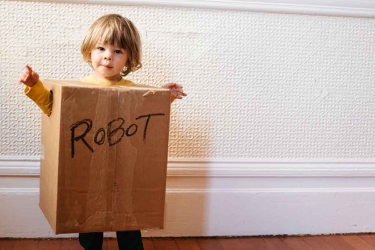 kid in a box labeled robot