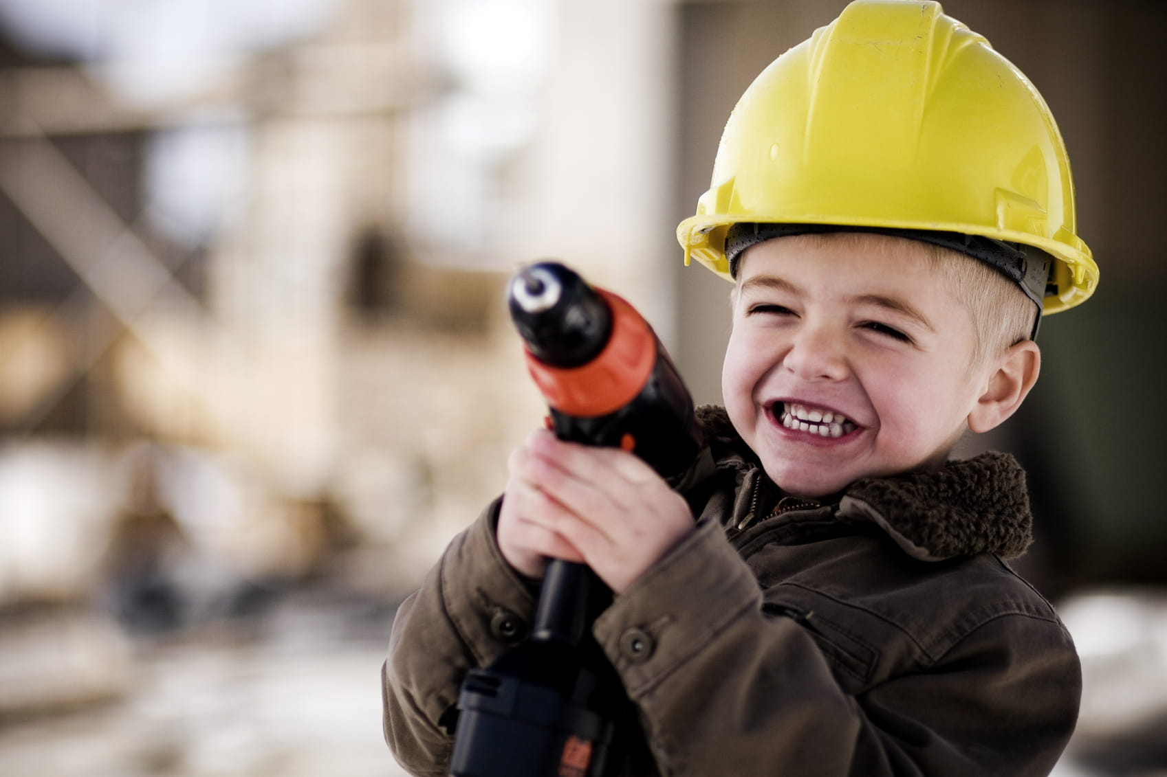 From cool yellow helmets to the bulldozer's beeps, construction sites are fantastic for building your child's understanding of the world. Photo by © Andrew Rich