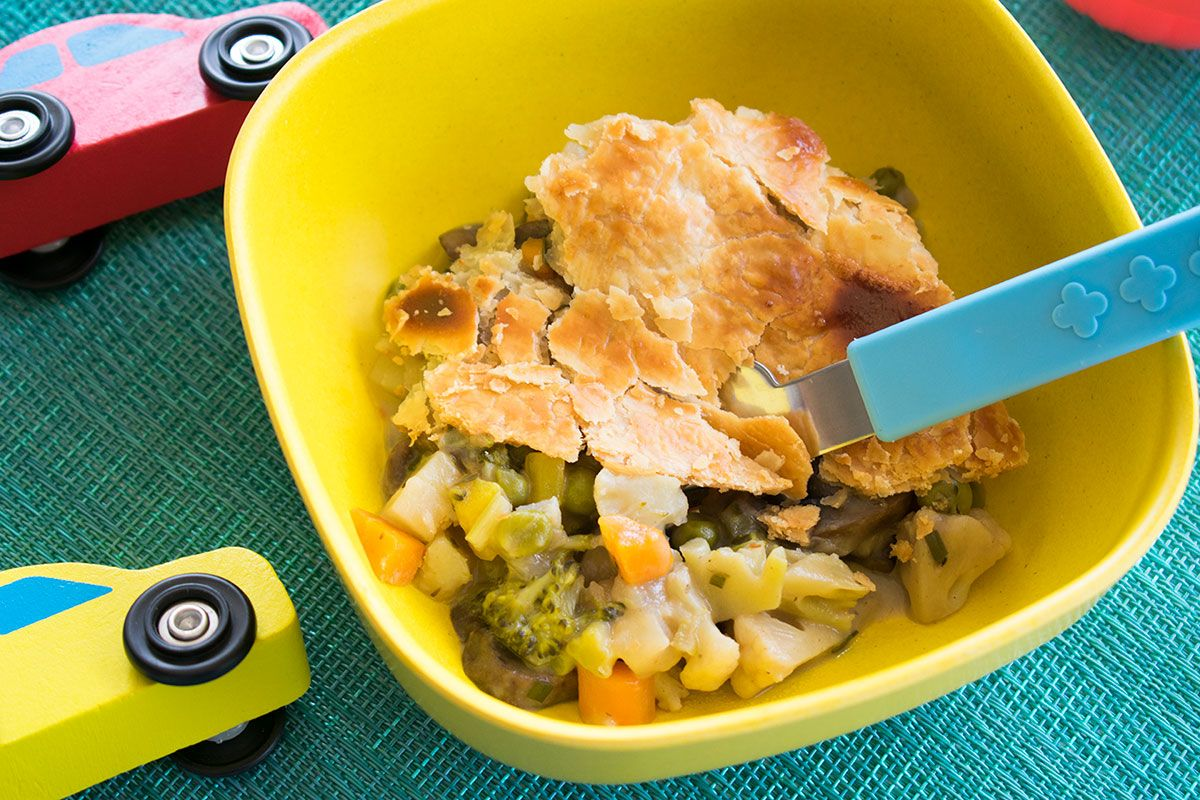 finished pot pie in bowl with toy cars