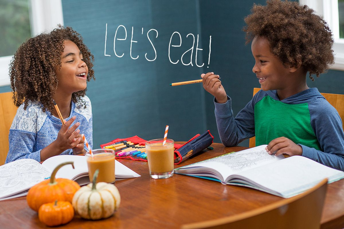 let's eat smoothies two kids having fun at table