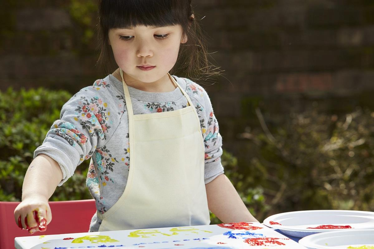 girl painting in smock