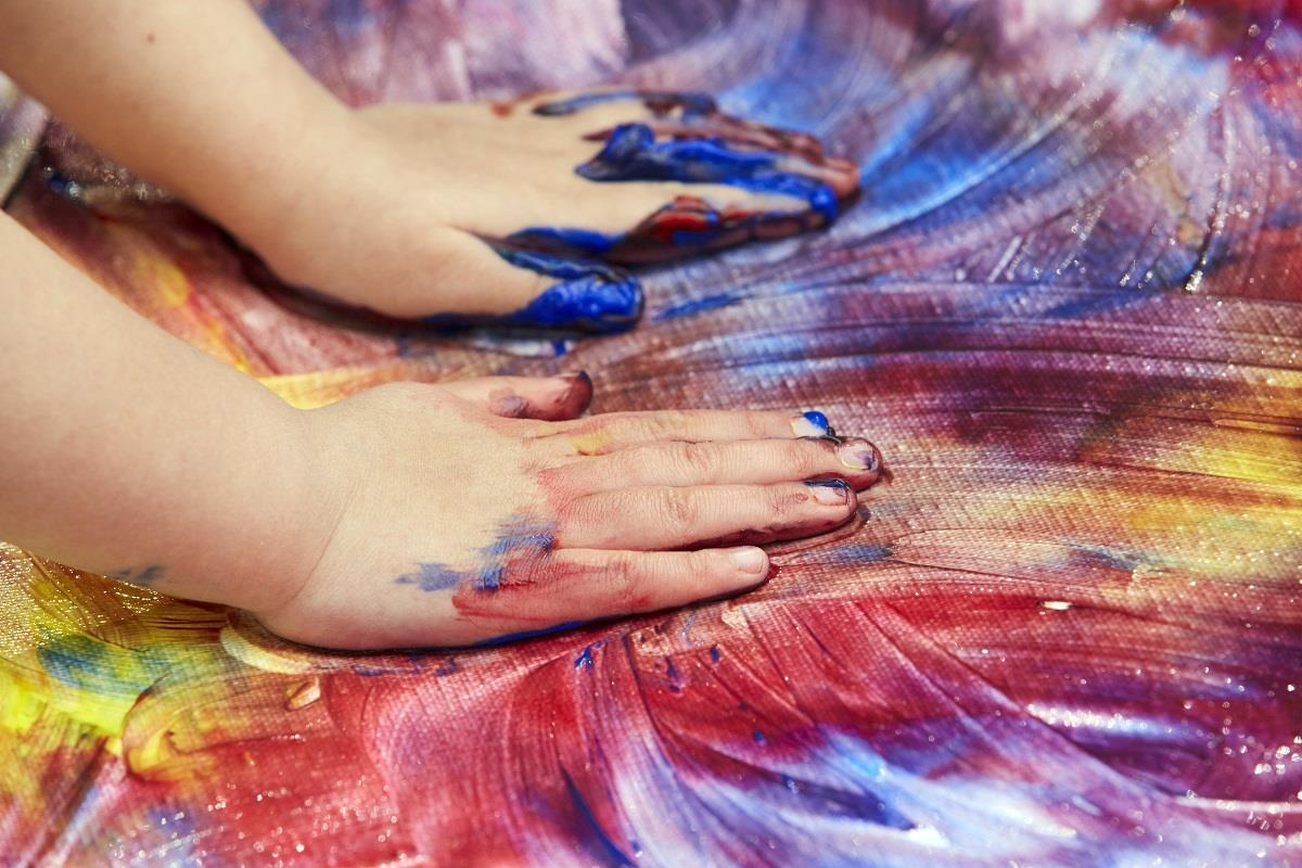making color swirls with paint and hands