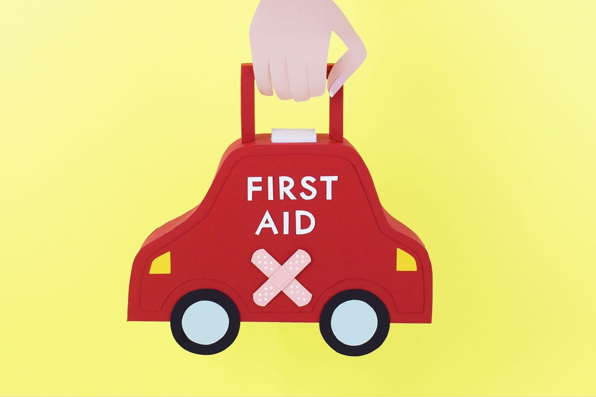 first aid kit in hand