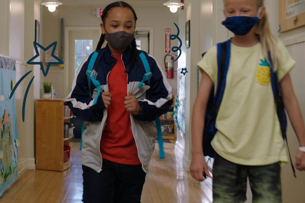 Children in masks walking in the hallway